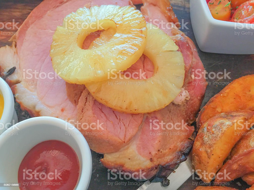 Gammon ham with sliced pineapple for celebrating Christmas festival stock photo