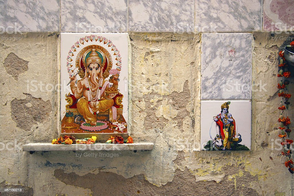 Ganesh and other hinduist religion symbols and drawings on a street...