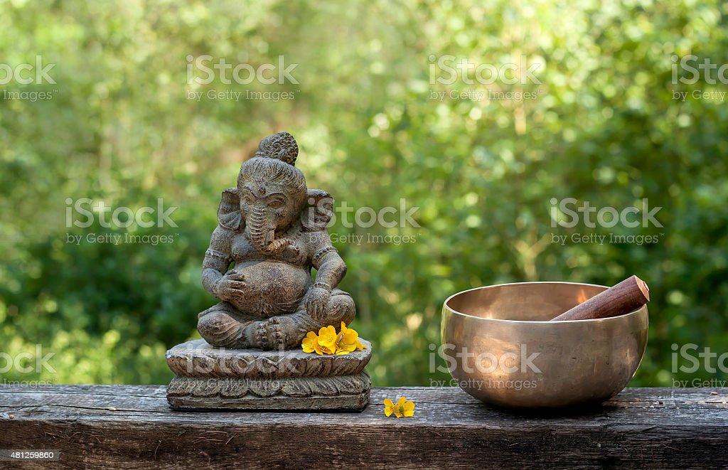 ganesha and tibetan bowl stock photo