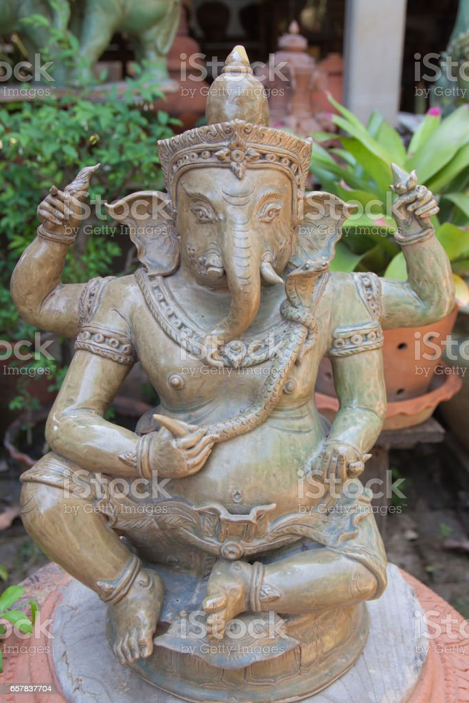 Ganesha baked clay statue in thai temple stock photo