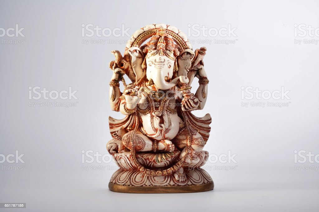 Ganesha sculpture indian lord ancient at white background stock photo