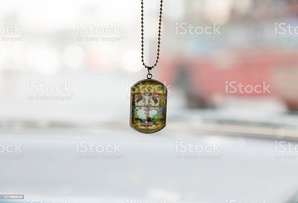 Ganesha's picture hanging on a vehicle mirror stock photo