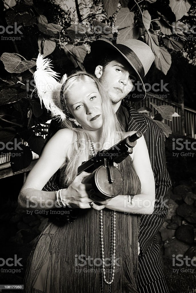 Gangster And His Gun Moll royalty-free stock photo