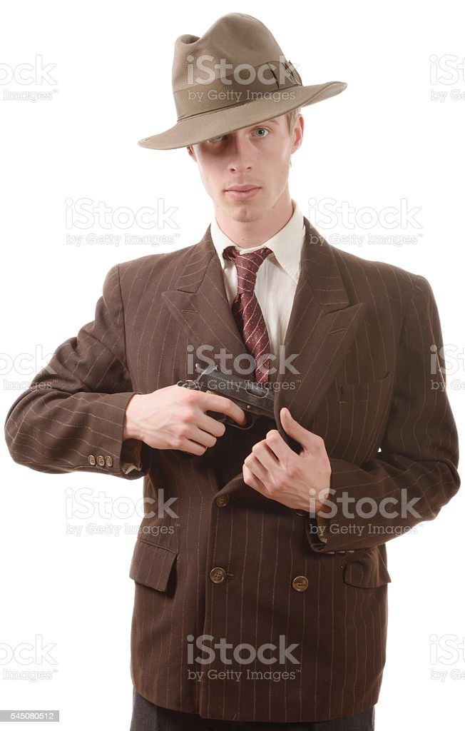gangster in a suit vintage, with handgun stock photo