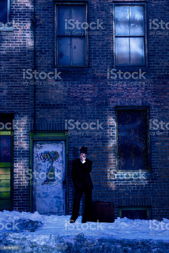 Gangster in front of abandoned buildings stock photo