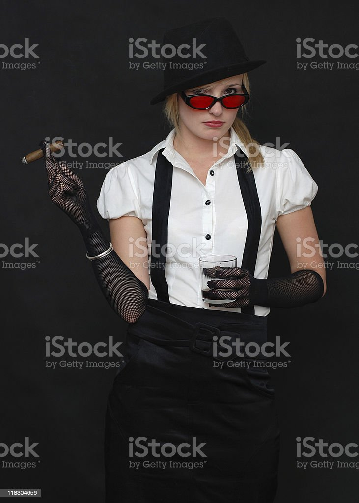Gangster lady holding cigar and glass of whisky stock photo