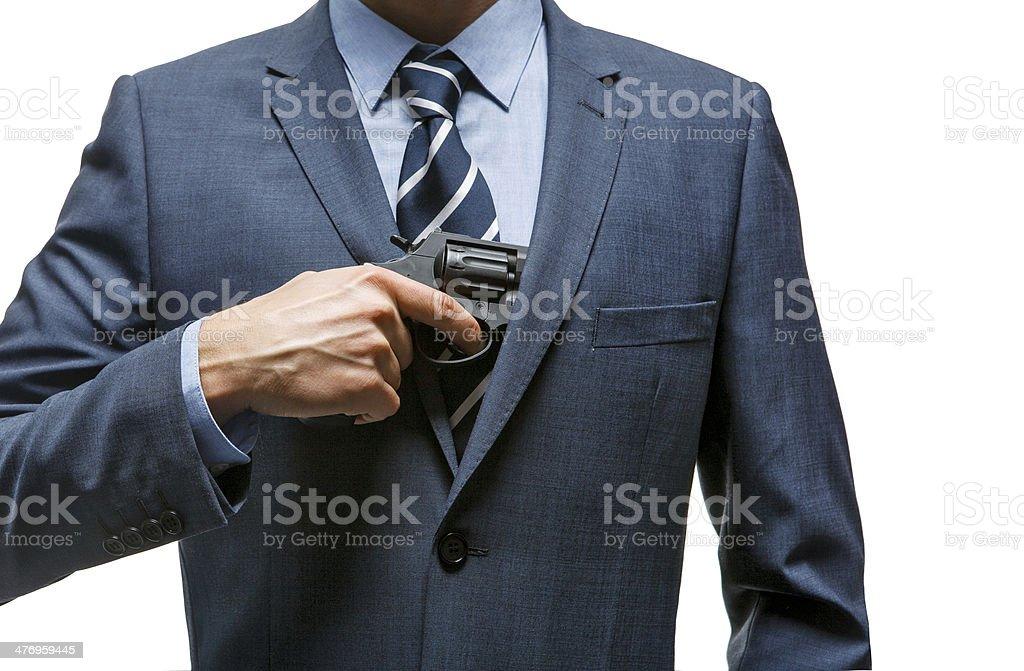 Gangster pulls out a gun stock photo