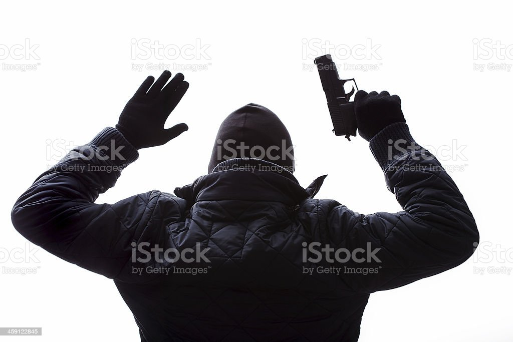 Gangster putting his hands up stock photo