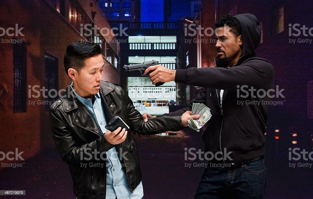 Gangster robbing a man stock photo