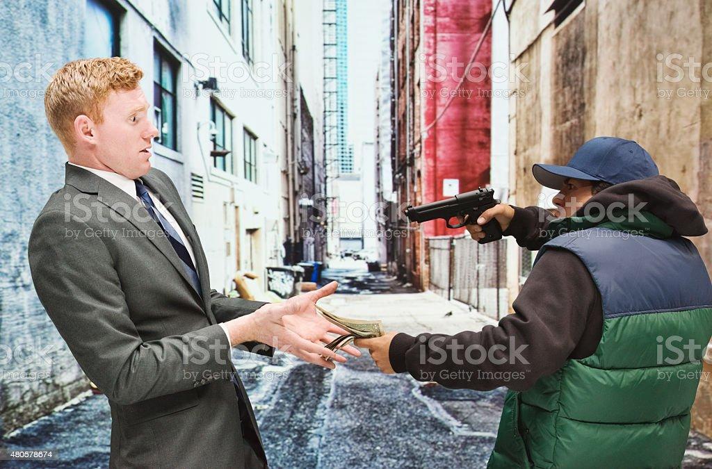 Gangster robbing businessman stock photo