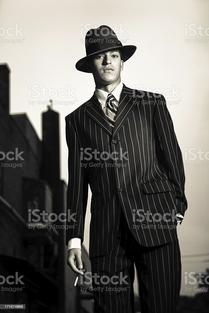 Gangster walking in an alley stock photo