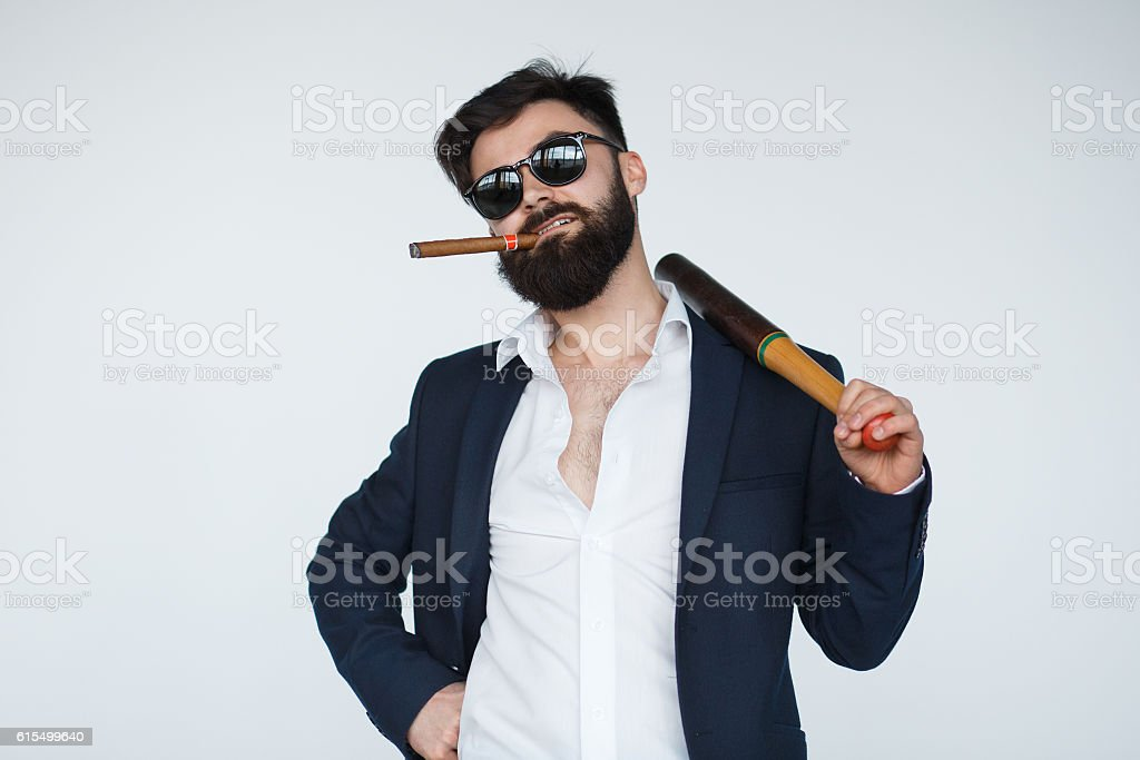 Gangster with baseball bat. Isolated on white stock photo