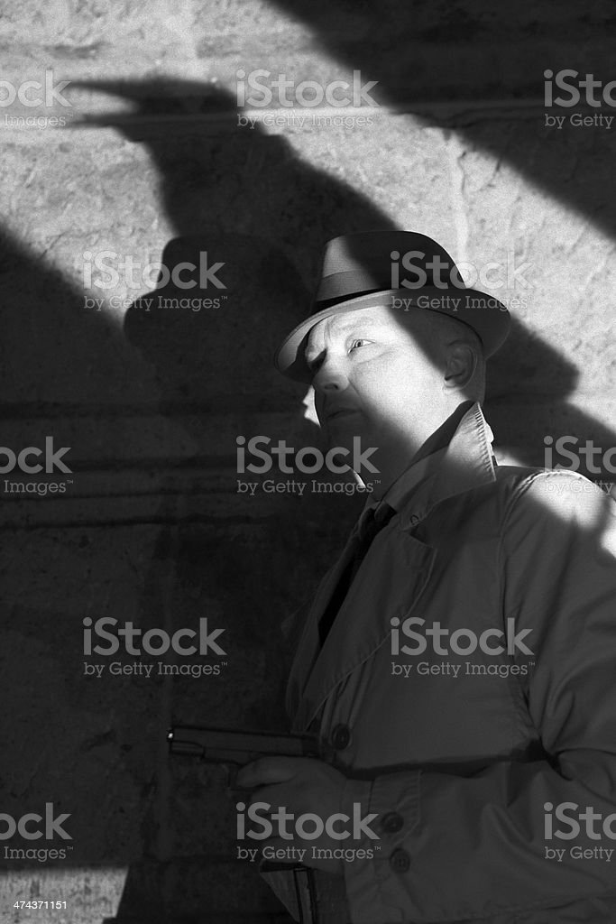Gangster with raven shadow - Film Noir stock photo