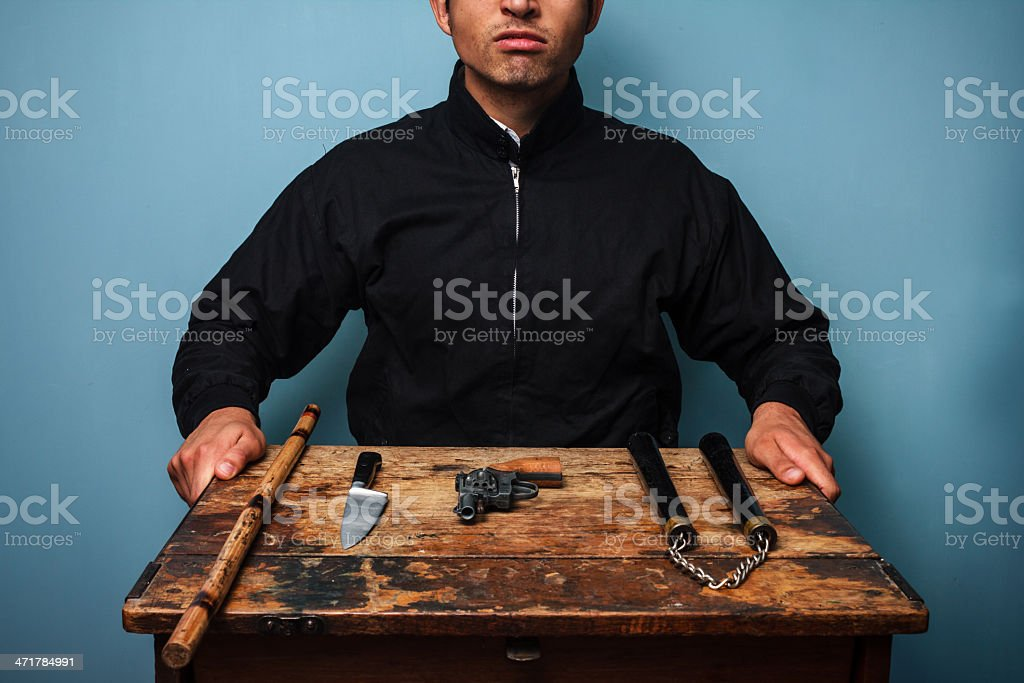 Gangster with various weapons royalty-free stock photo