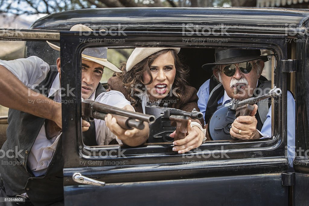 Gangsters Shooting From Car stock photo