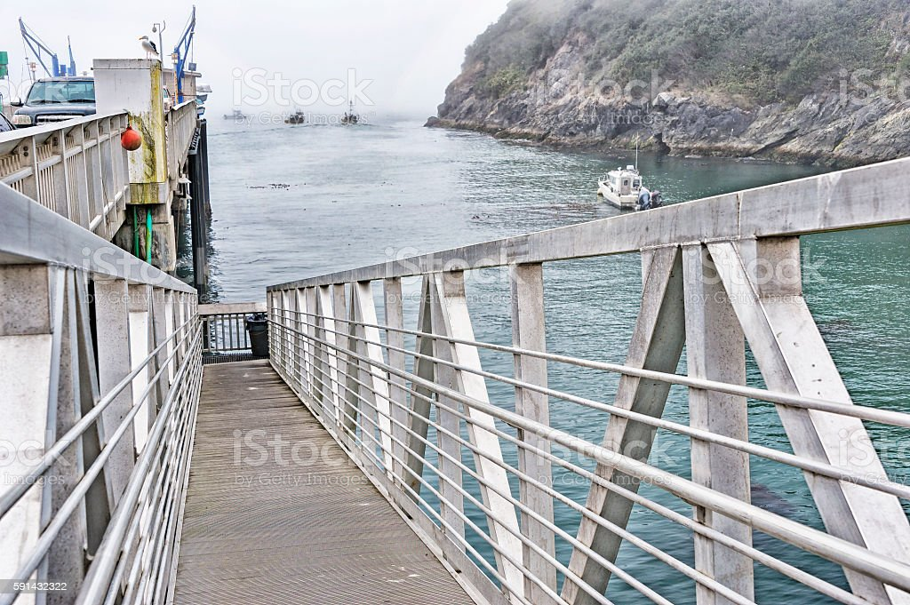 Gangway under the Pier to the Fishing Boats with Fog stock photo