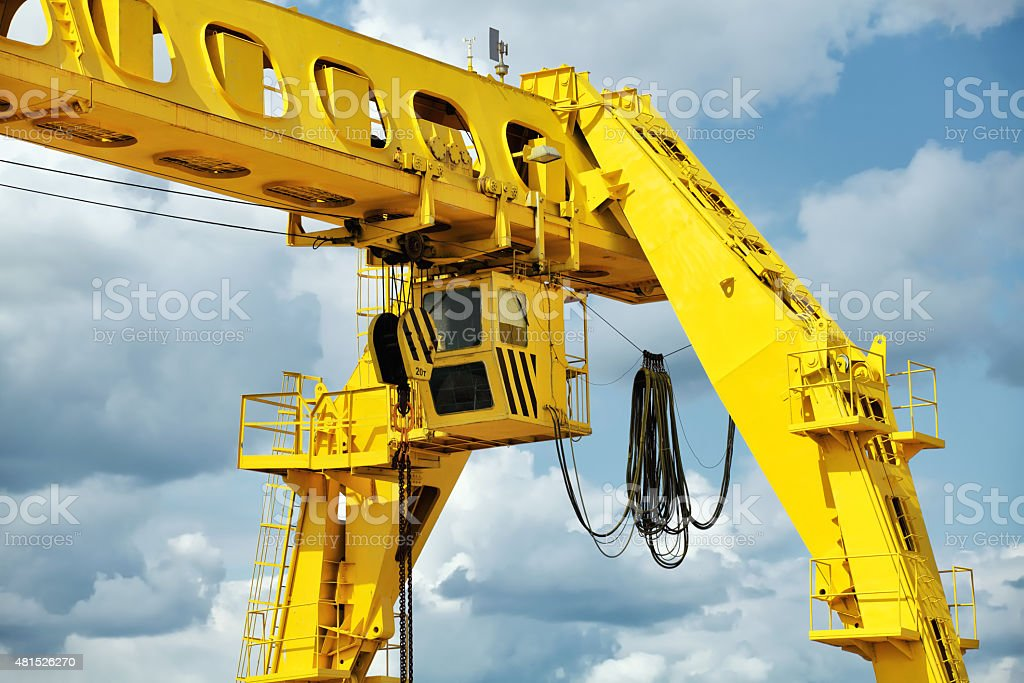 Gantry crane against the blue sky stock photo