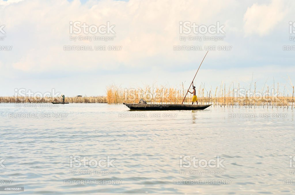 Ganvie Man Poling Skiff royalty-free stock photo
