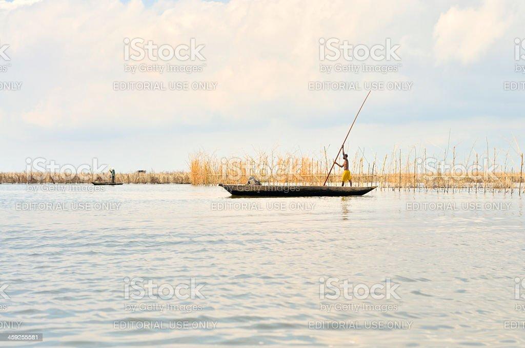 Ganvie Man Poling Skiff stock photo
