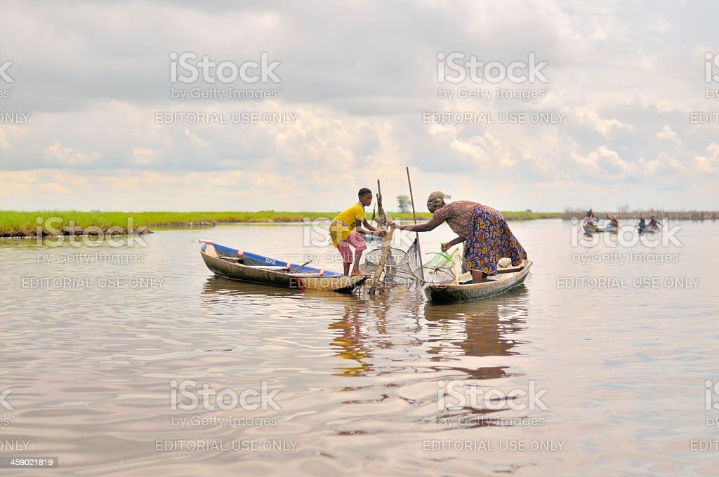 Ganvie Mother And Son Fishing stock photo