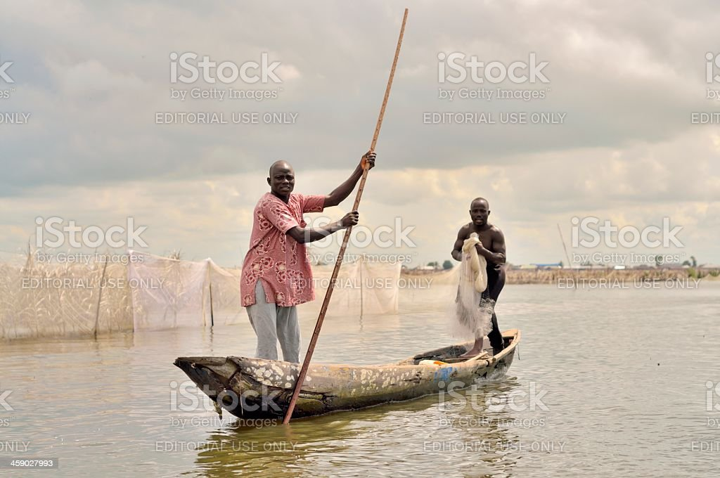 Ganvie Village Fishermen In A Dugout royalty-free stock photo