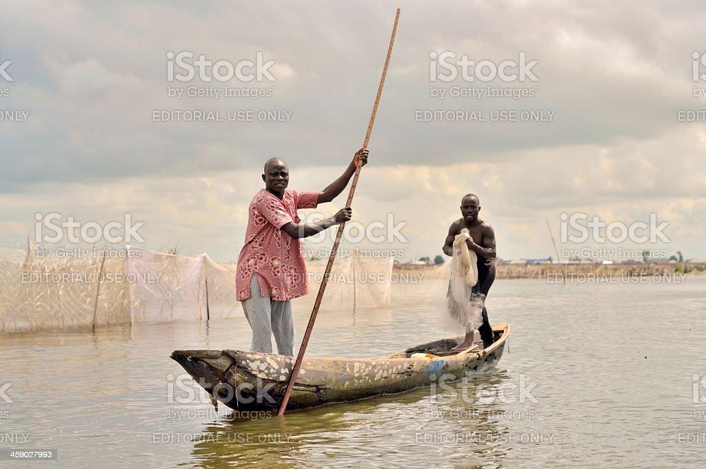 Ganvie Village Fishermen In A Dugout stock photo