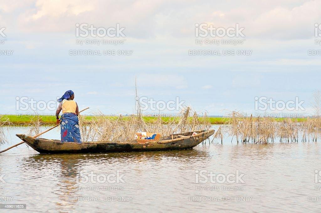 Ganvie Woman Poling Dugout stock photo