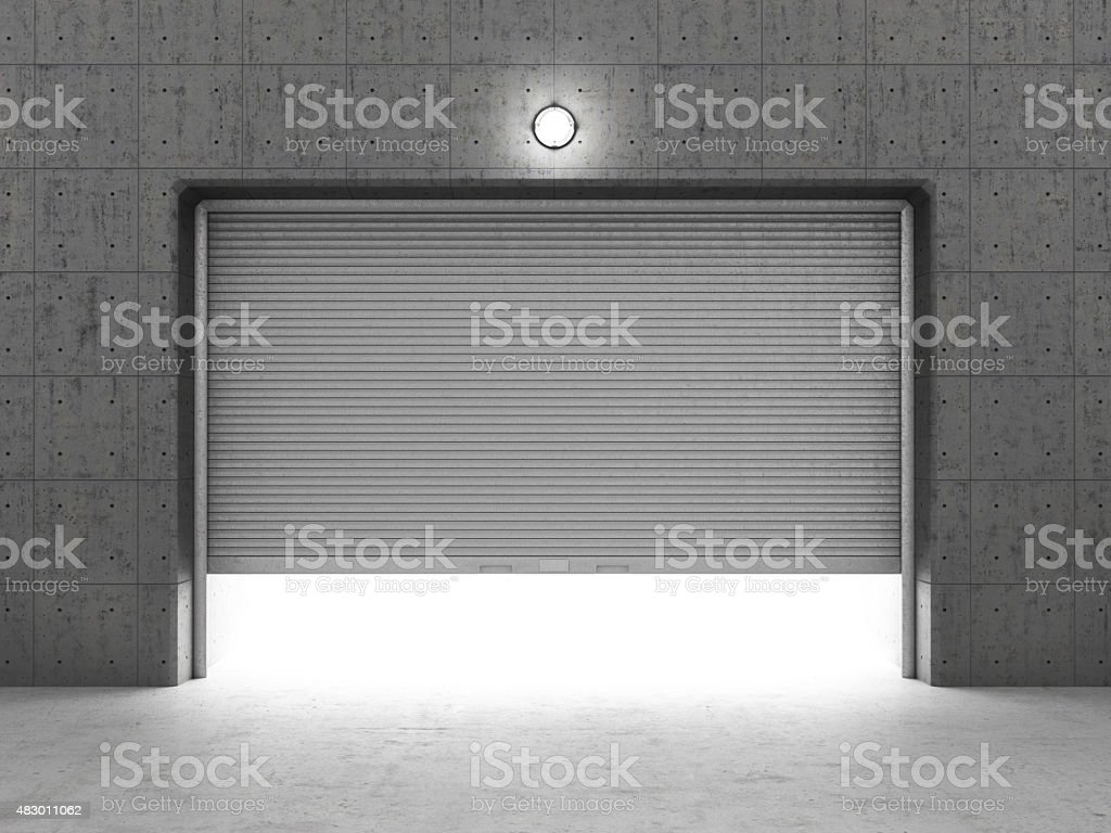 Garage building made of concrete with roller shutter doors. stock photo