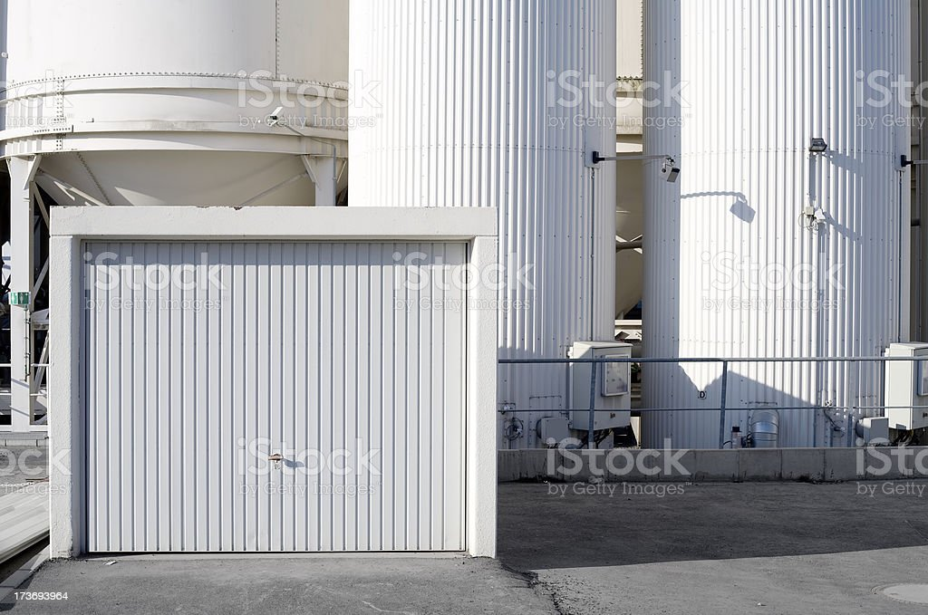 Garage door and silos royalty-free stock photo