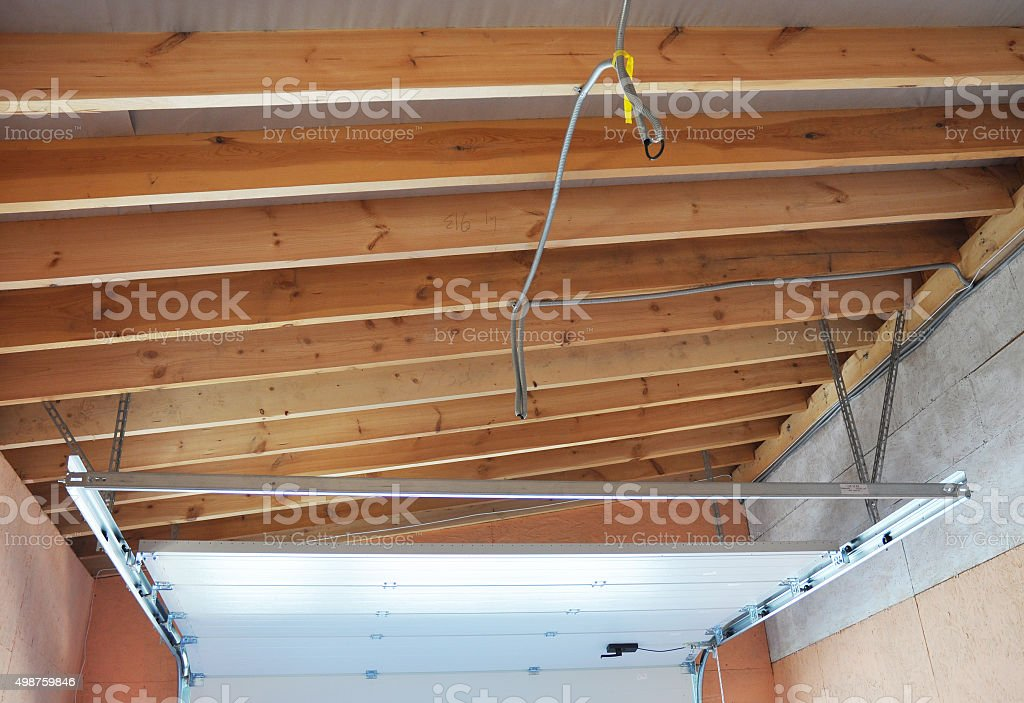 Garage Door Post Rail and Spring Installation Assembly Garage Ceilling. stock photo