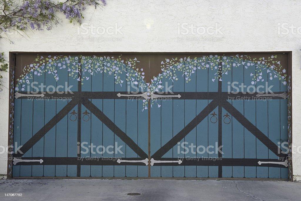 Garage Door with Hand-painted Mural stock photo