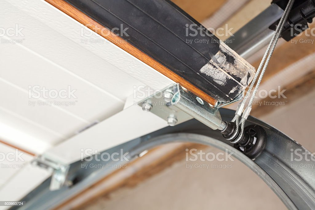 Garage doors installation. Close-up of lifting system in metal profil stock photo