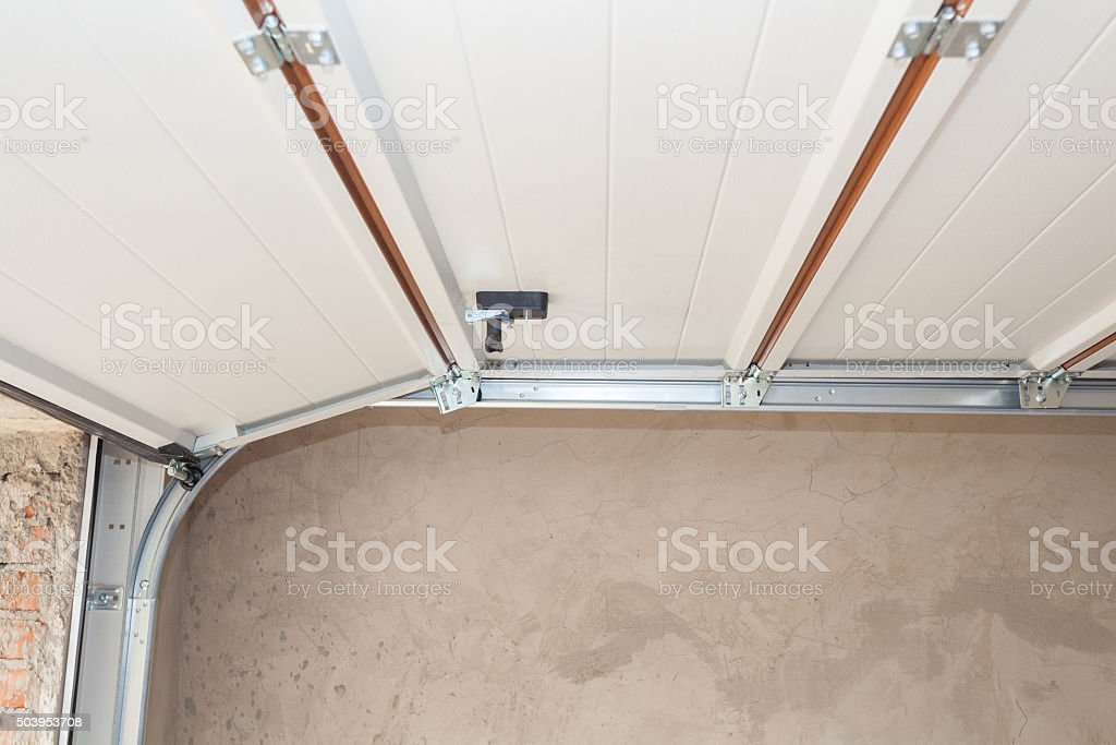 Garage doors installation. Post Rail and Spring Installation / Assembly. stock photo