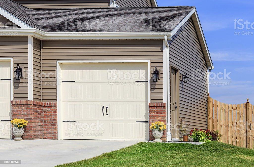 Garage Door,Vinyl Siding,Roof,Fence royalty-free stock photo