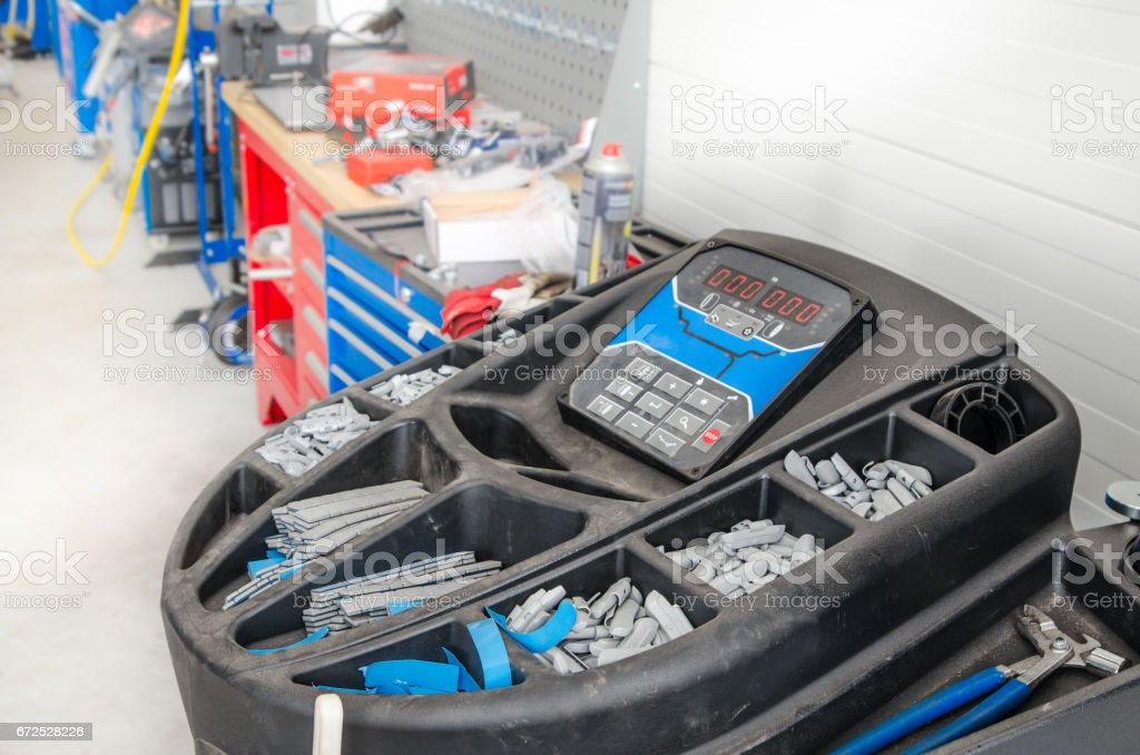 Garage, equipment for mounting and balancing wheels of cars stock photo