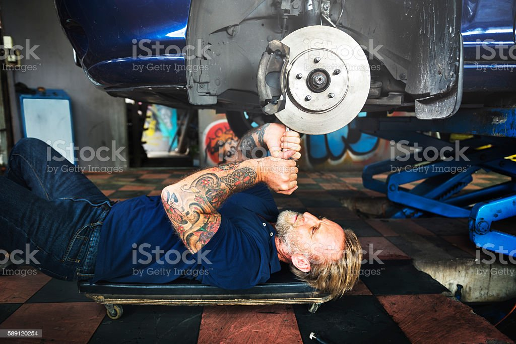 Garage Motor Maintenance Mechanic Fixing Spare Concept stock photo