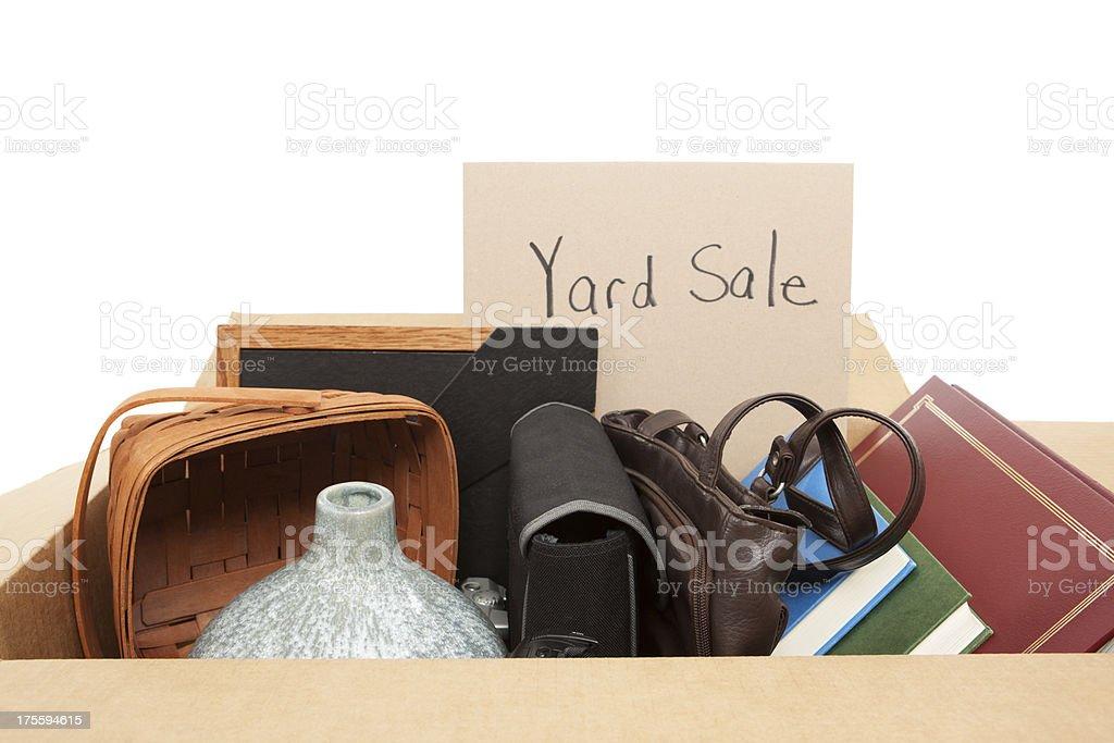 Garage Sale: Cardboard Box of Household Items stock photo