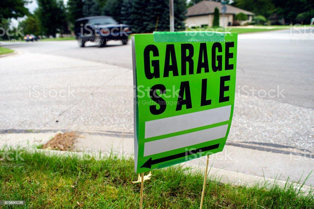 Garage Sale Sign Next to Neighborhood Street stock photo
