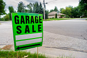 Garage Sale Sign Next to Neighborhood Street