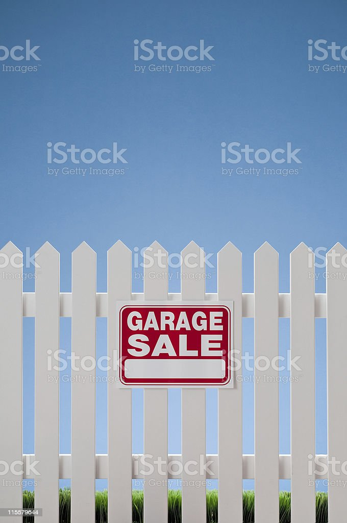 Garage Sale Sign On White Picket Fence royalty-free stock photo
