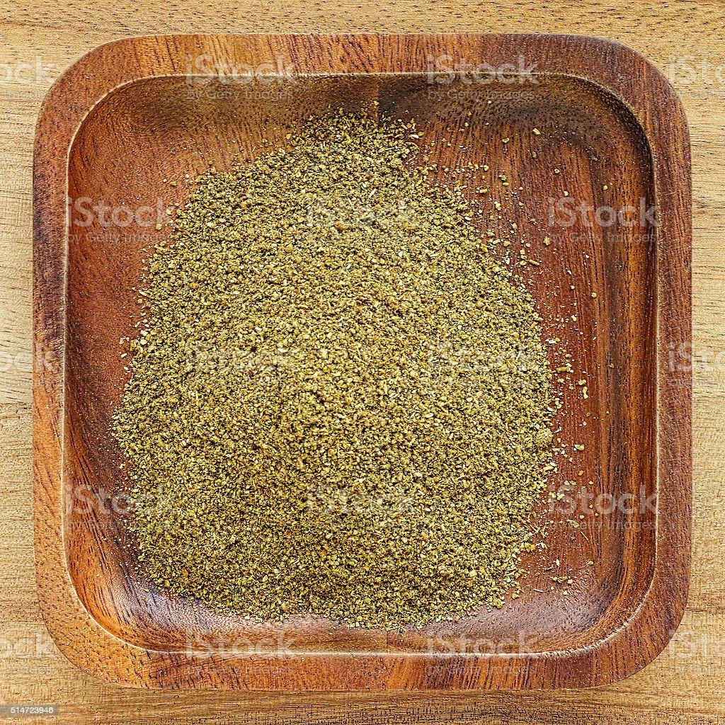 Garam masala powder in a wooden tray. stock photo