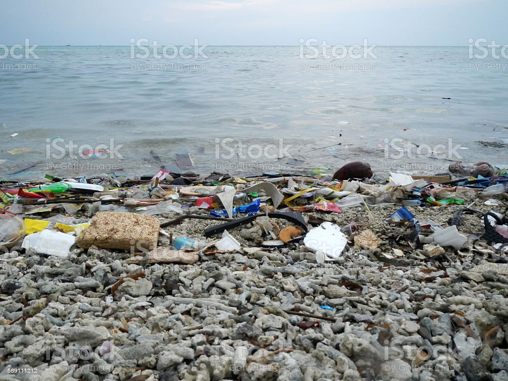 Garbage and wastes on the beach stock photo