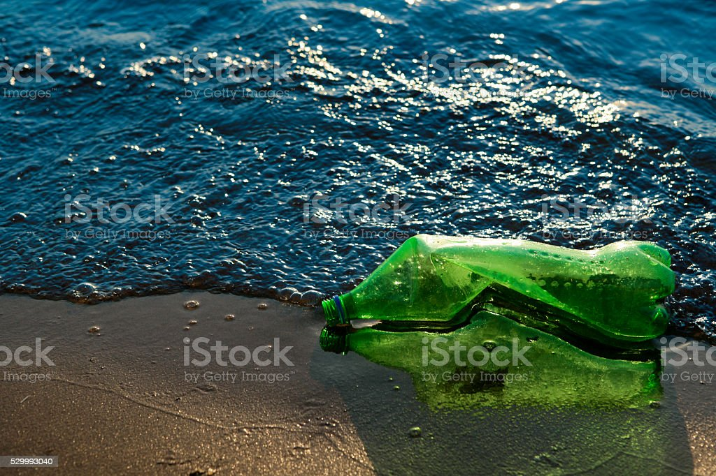 Garbage at the seashore stock photo