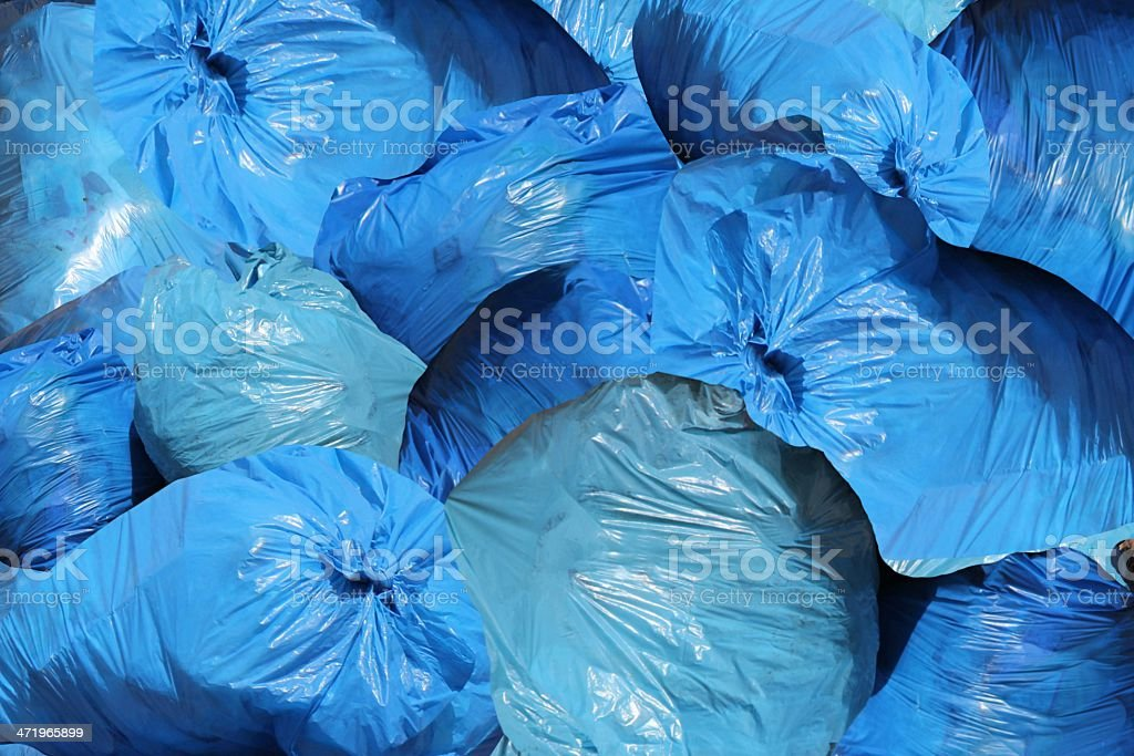 Garbage bags by a city street. stock photo