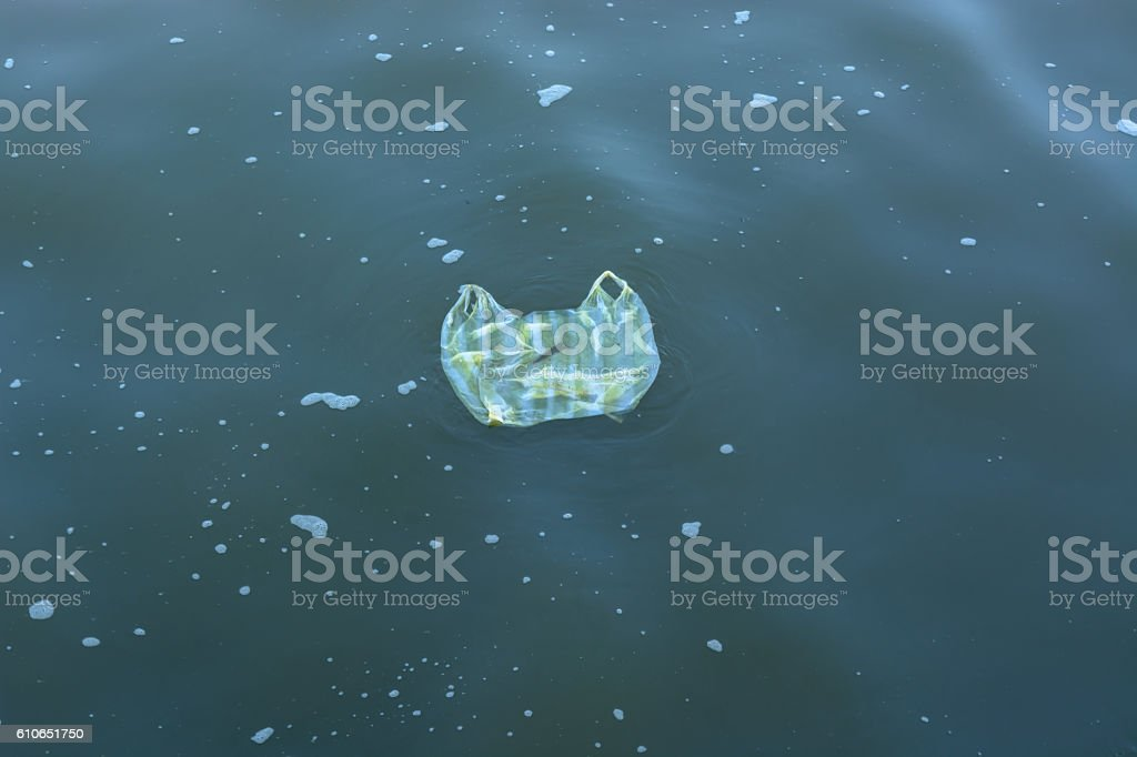 Garbage bags floating in the sea stock photo