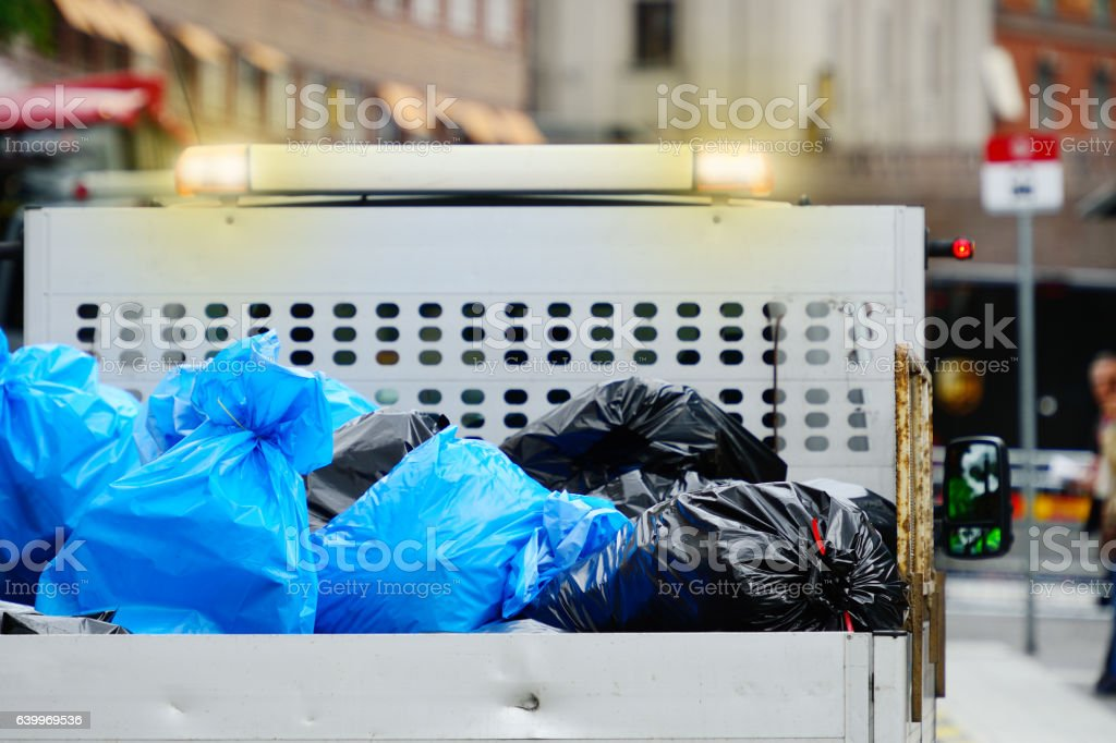 Garbage bags on truck stock photo