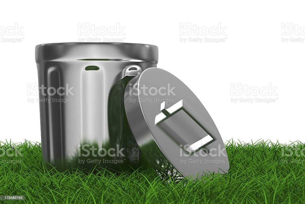 Garbage basket on grass. Isolated 3D image royalty-free stock photo