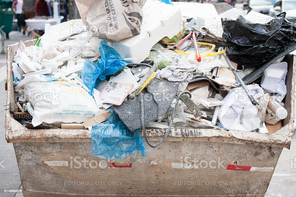 Garbage bin filled with junk stock photo