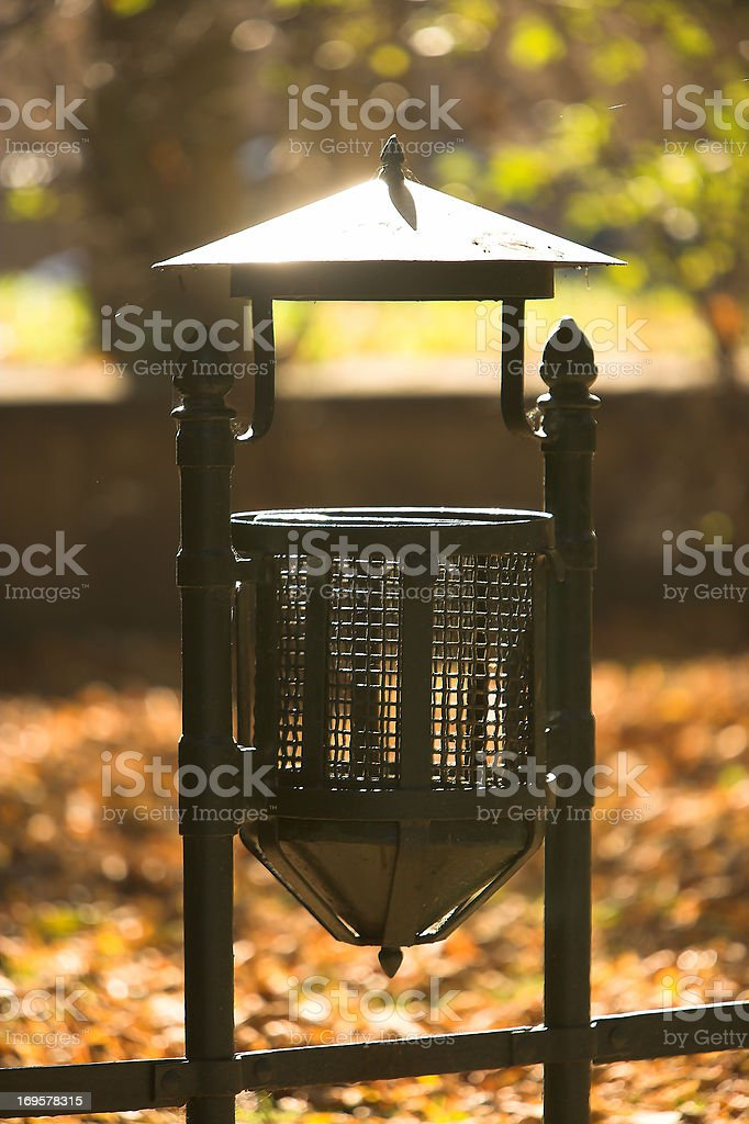 A garbage bin in the autumn stock photo