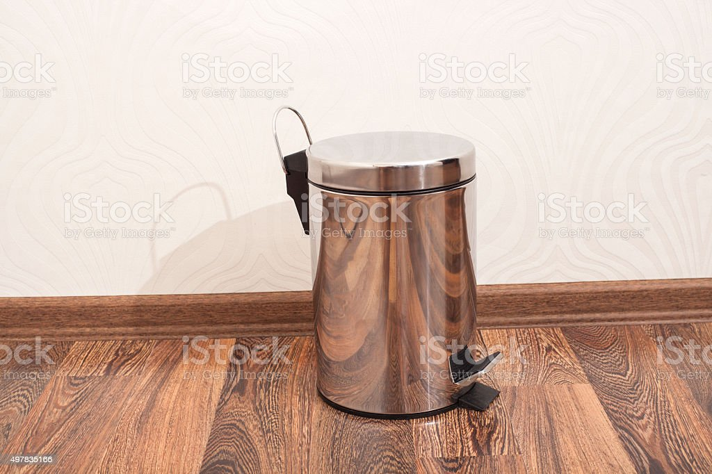 Garbage bin on the floor in  room stock photo